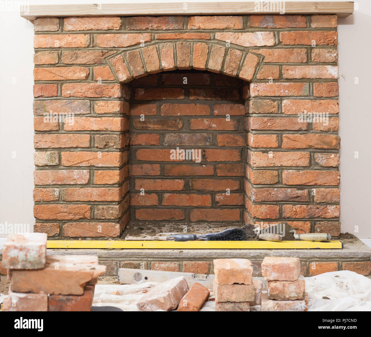 indoor diy project building fireplace in the house laying bricks template for the arch. Black Bedroom Furniture Sets. Home Design Ideas