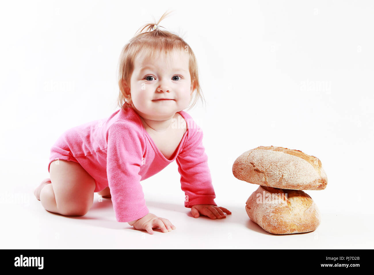 Little child with bread - Stock Image