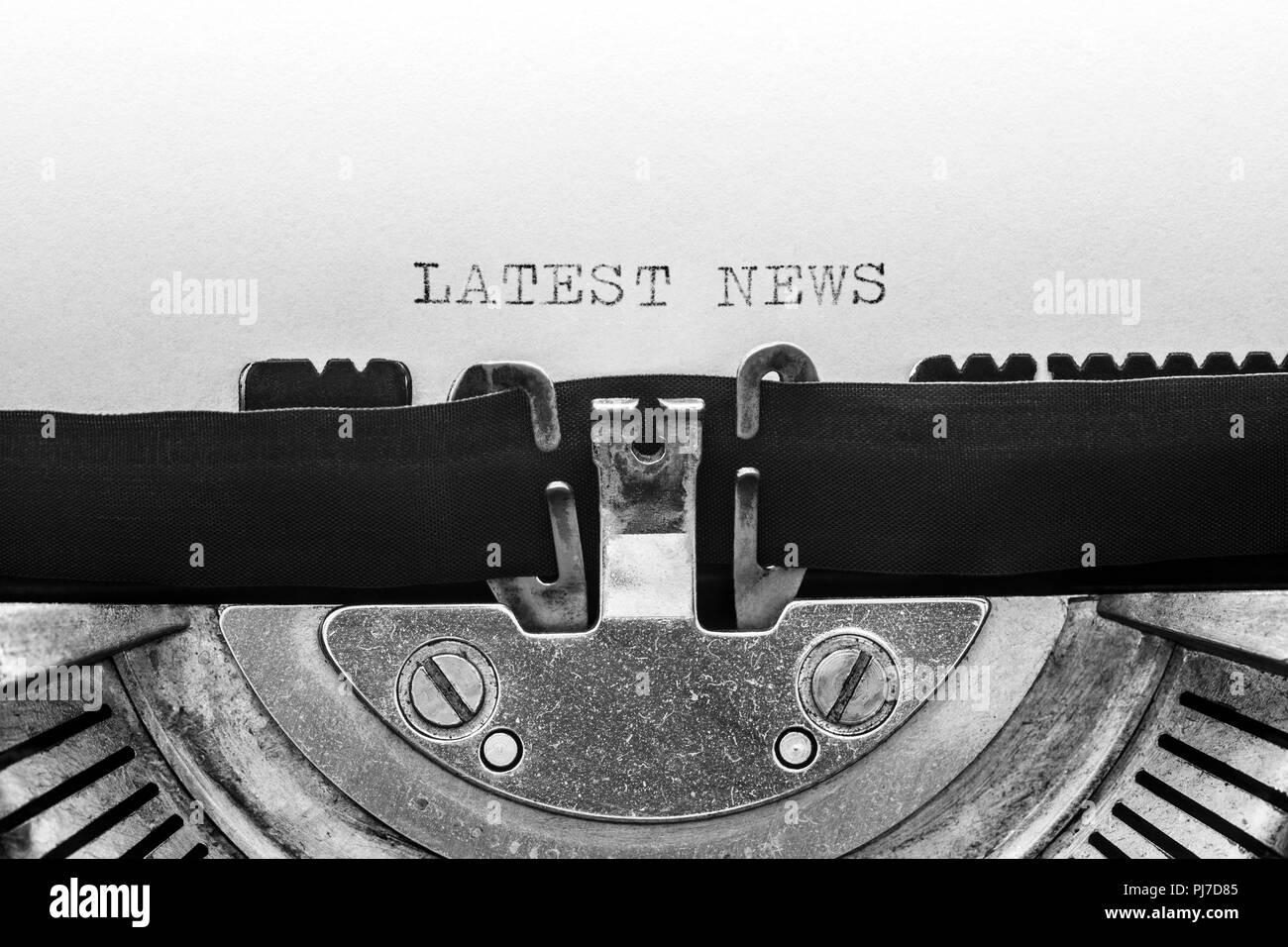 Latest news typed on a vintage typewriter - Stock Image