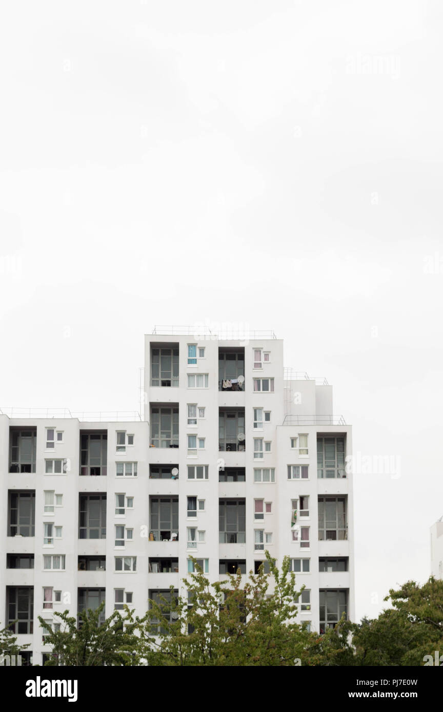 Minimalist architecture. Residential tower with bright light and white color. & Minimalist architecture. Residential tower with bright light and ...