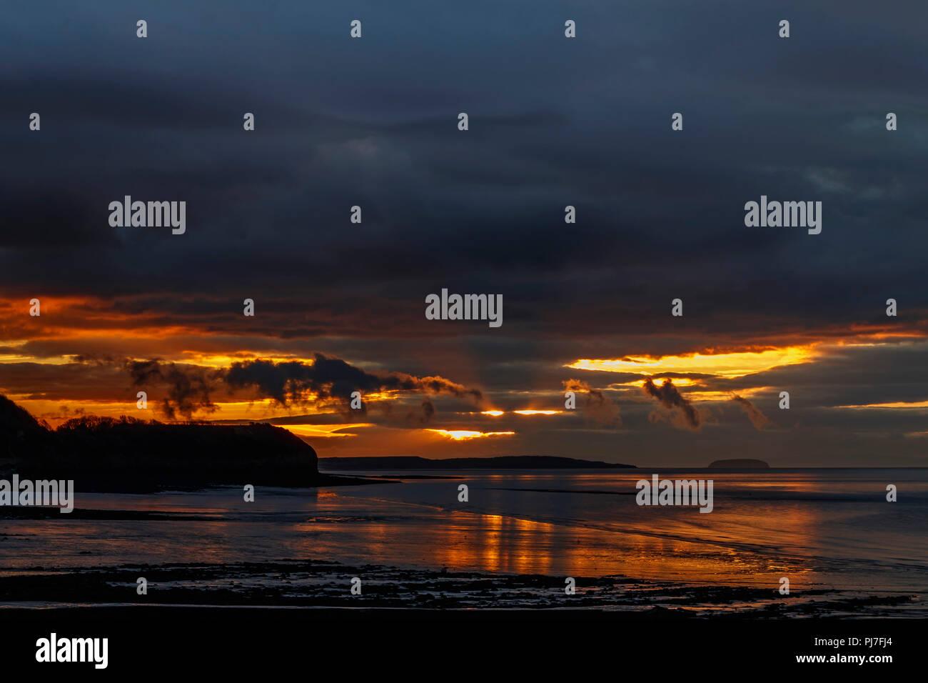 Sunlight reflecting onto the Clevedon mud - Stock Image