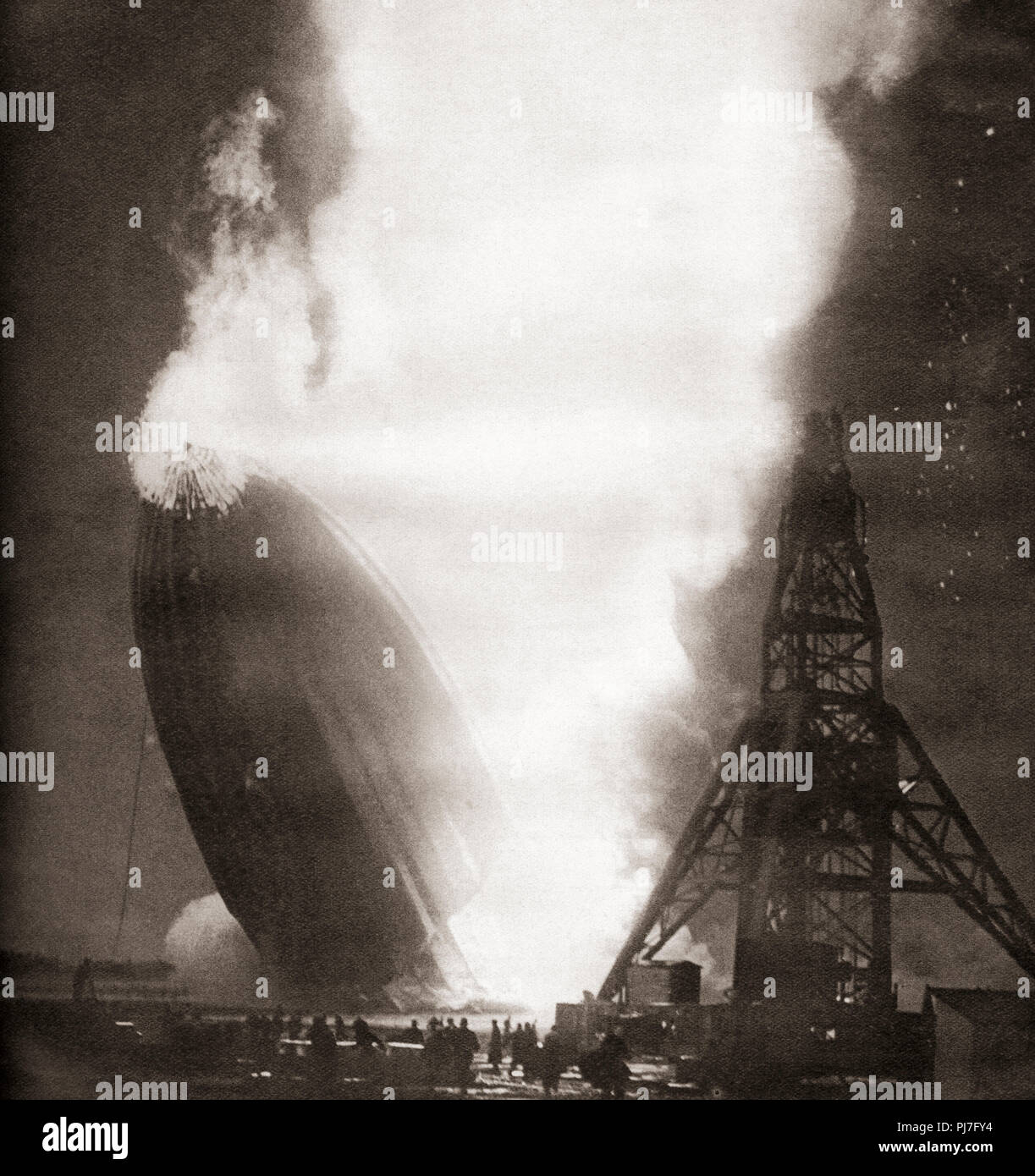 The Hindenburg disaster, May 6, 1937.  The German passenger airship LZ 129 Hindenburg caught fire and was destroyed whilst trying to dock with its mooring mast at the Naval Air Station Lakehurst,  Manchester Township, New Jersey, United States of America.  From These Tremendous Years, published 1938. - Stock Image