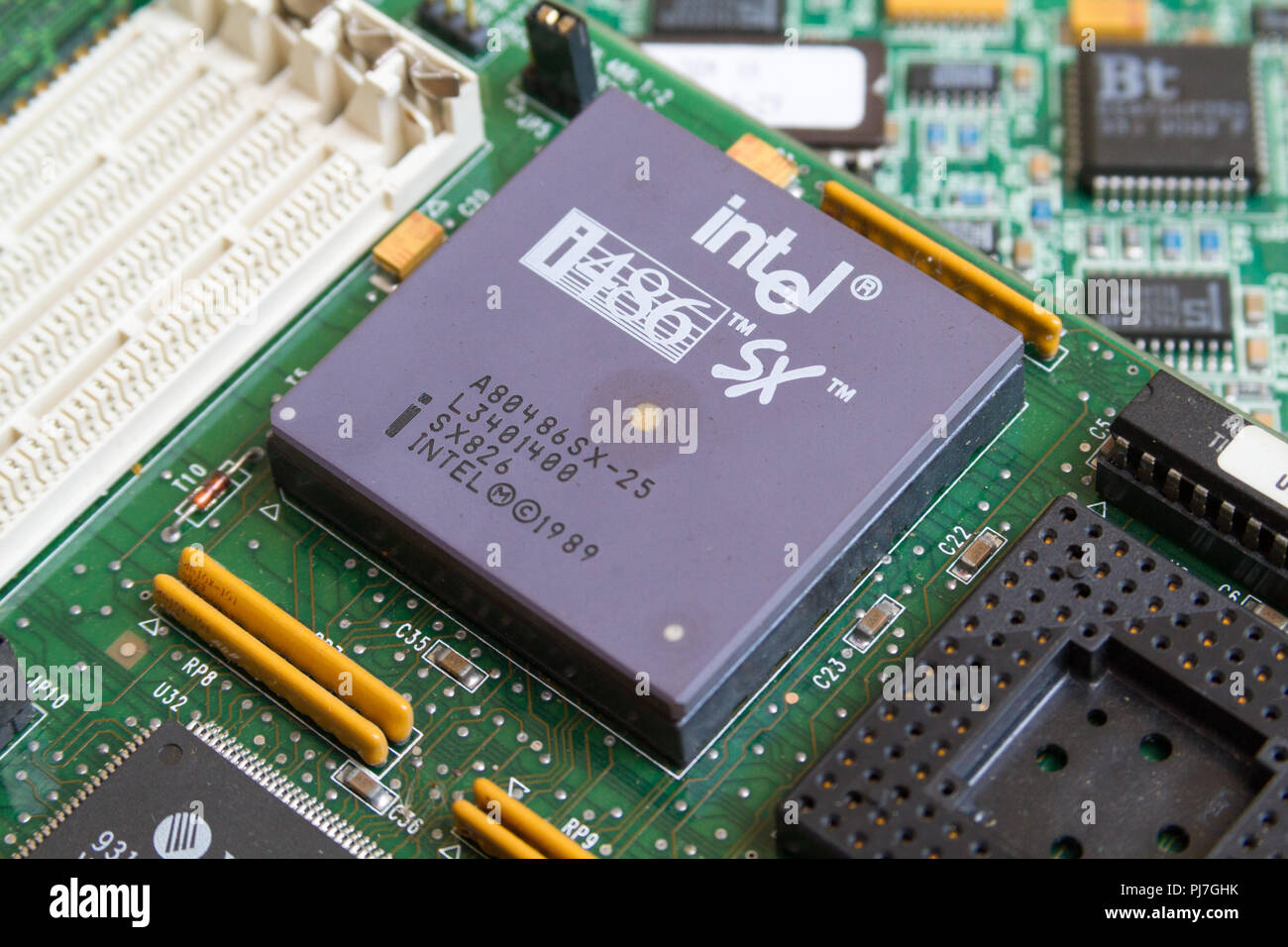 An Intel i486 SX (80486SX) processor (CPU) from 1989 in a socket on a motherboard. Caklov, Slovakia. 2018/7/28. - Stock Image