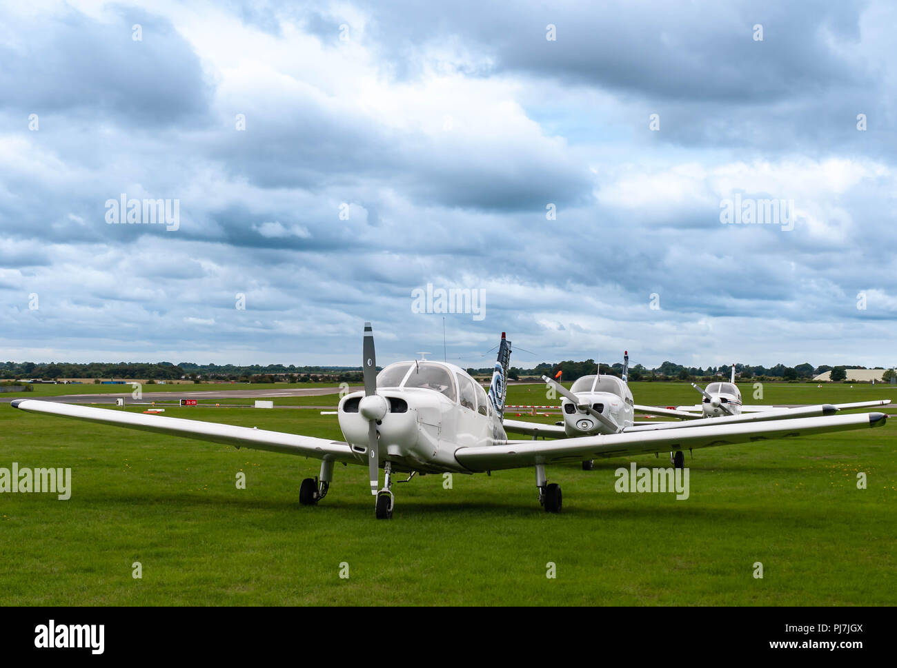 Three light aircraft in line - Stock Image