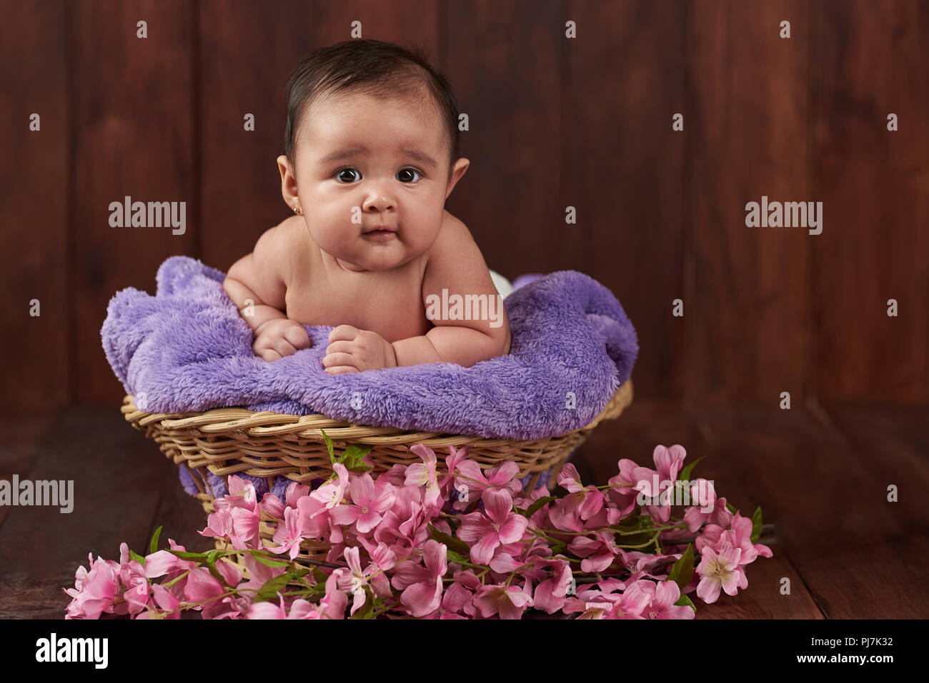 Smile Happy Cute Baby Girl On Dark Wooden Background Stock Photo