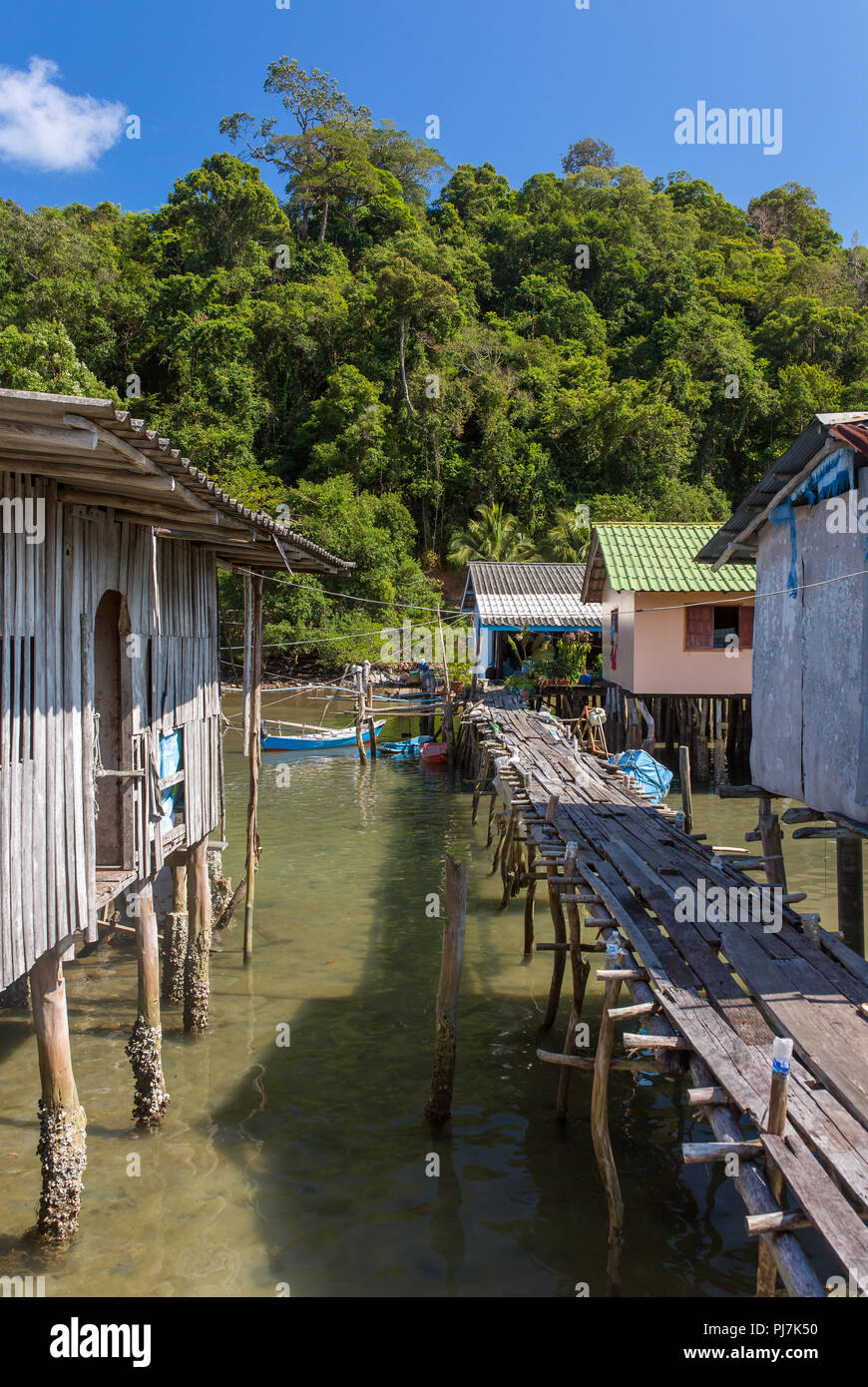 Stilt houses in Baan AoYai Salad port and fishing village on Koh Kood Island, Thailand - Stock Image