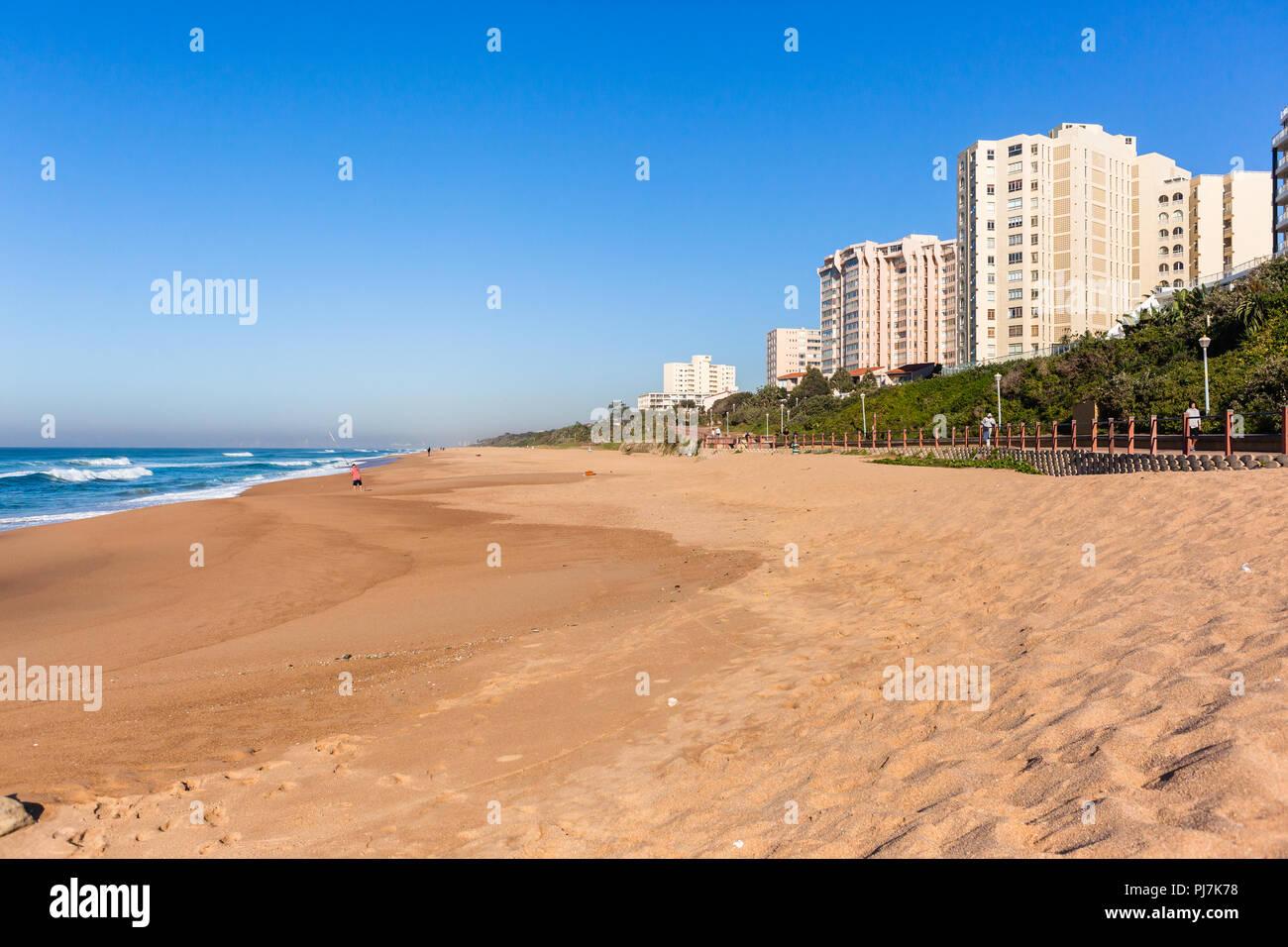 Beach ocean landscape with flat apartment buildings holiday lifestyle  coastline landscape. - Stock Image