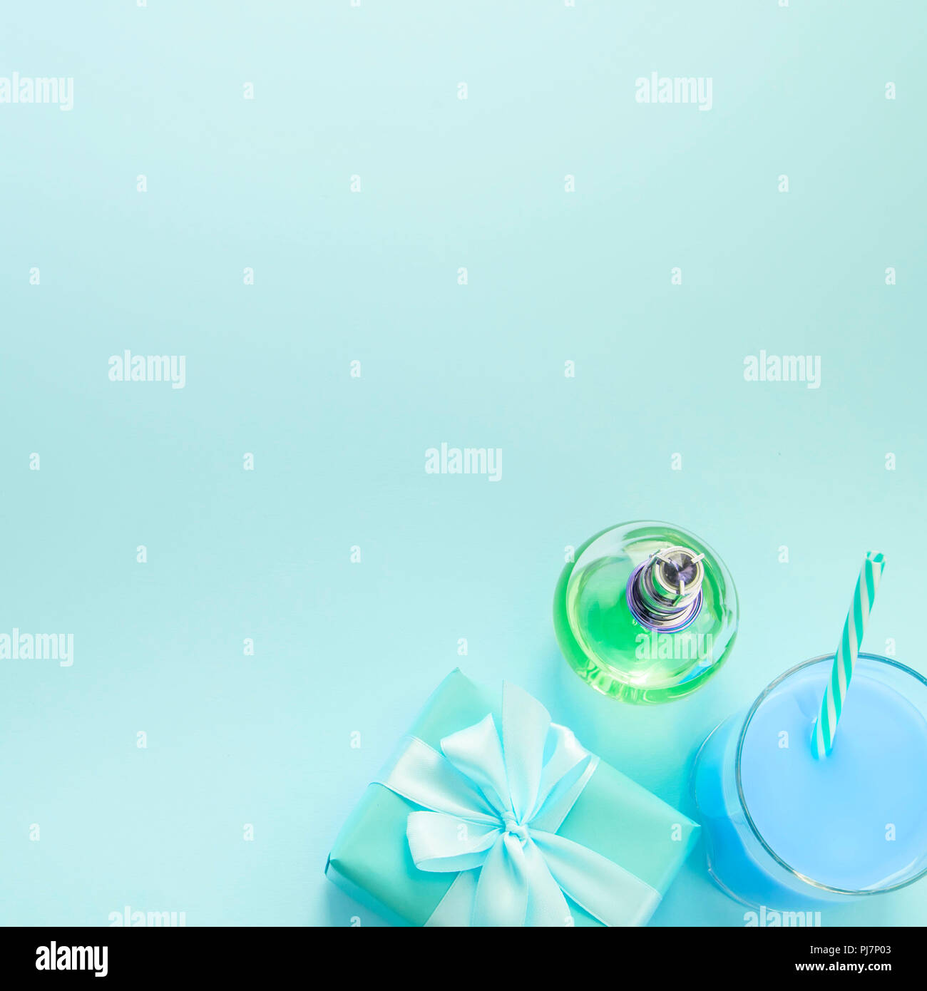 Surrealiam Composition flat lay gift to a woman glass cocktail perfume bouquet of flowers. Preparing for the holiday surprise gift box. Top view blue  - Stock Image