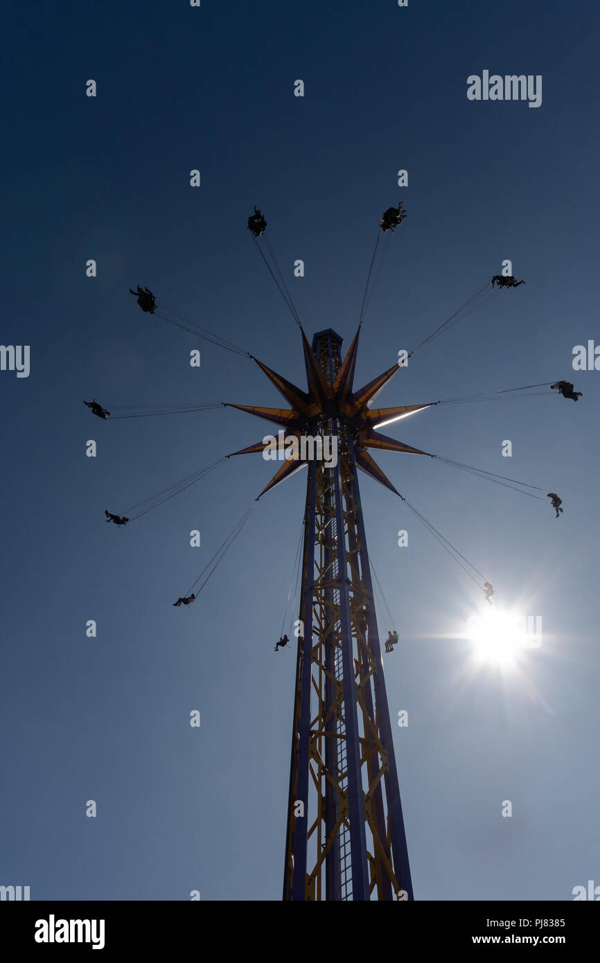 Towering, spinning carnival ride - Stock Image