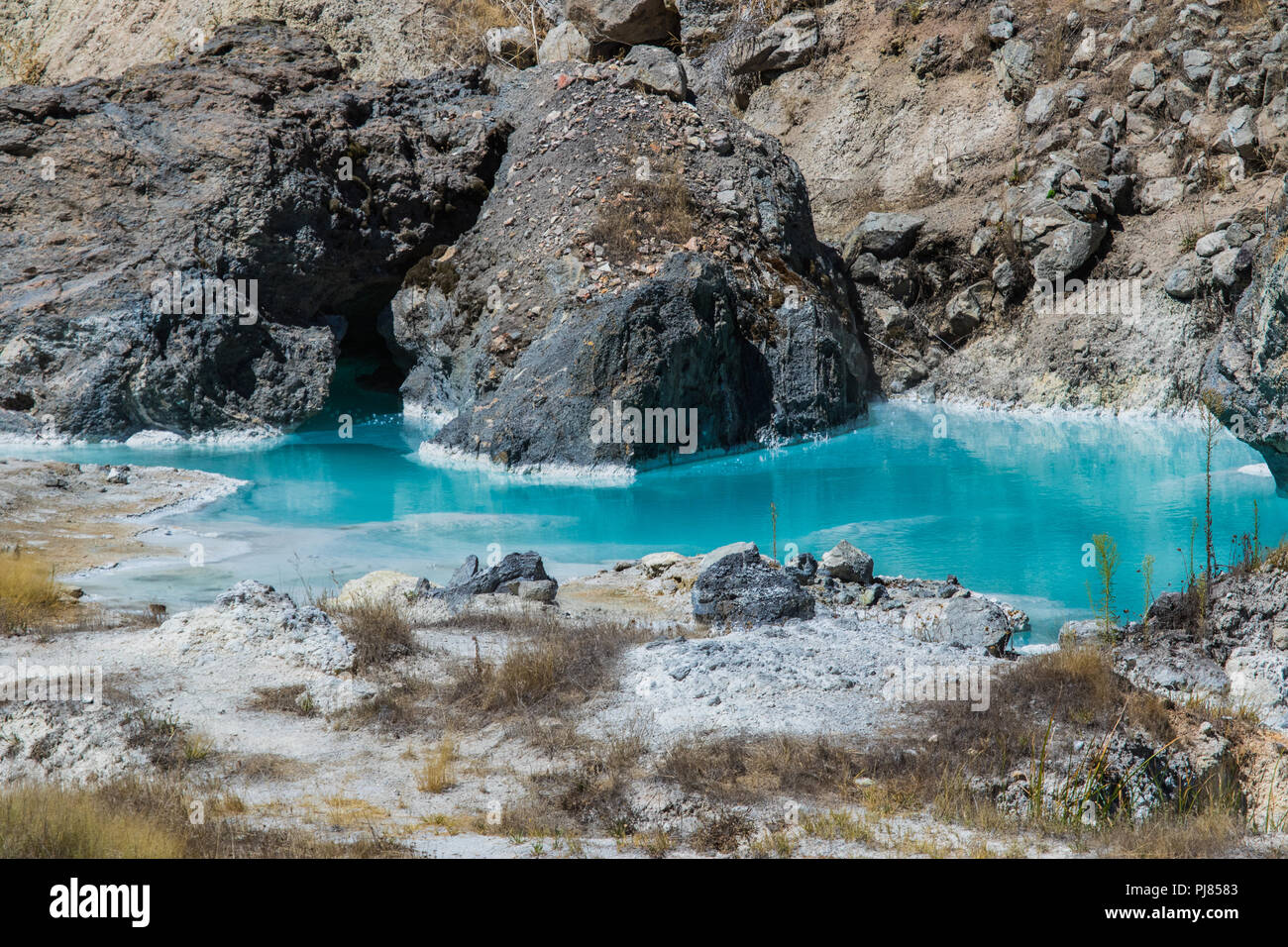 Hot Creek is part of The Long Valley Caldera hosts an active hydrothermal system that includes hot springs, fumaroles steam vents and mineral deposits - Stock Image