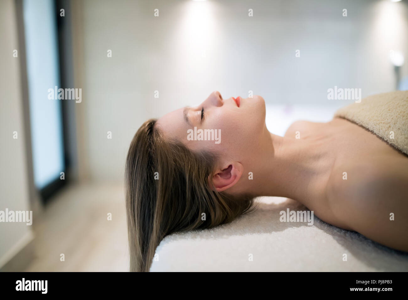 Relaxing anti stress facial massage Stock Photo