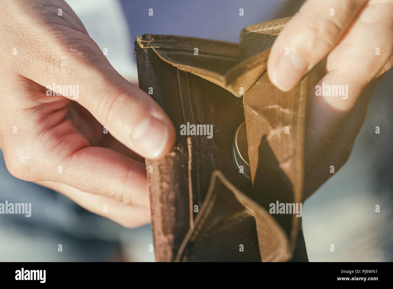 Open purse with coins inside close-up as a sign of lack of money Stock Photo