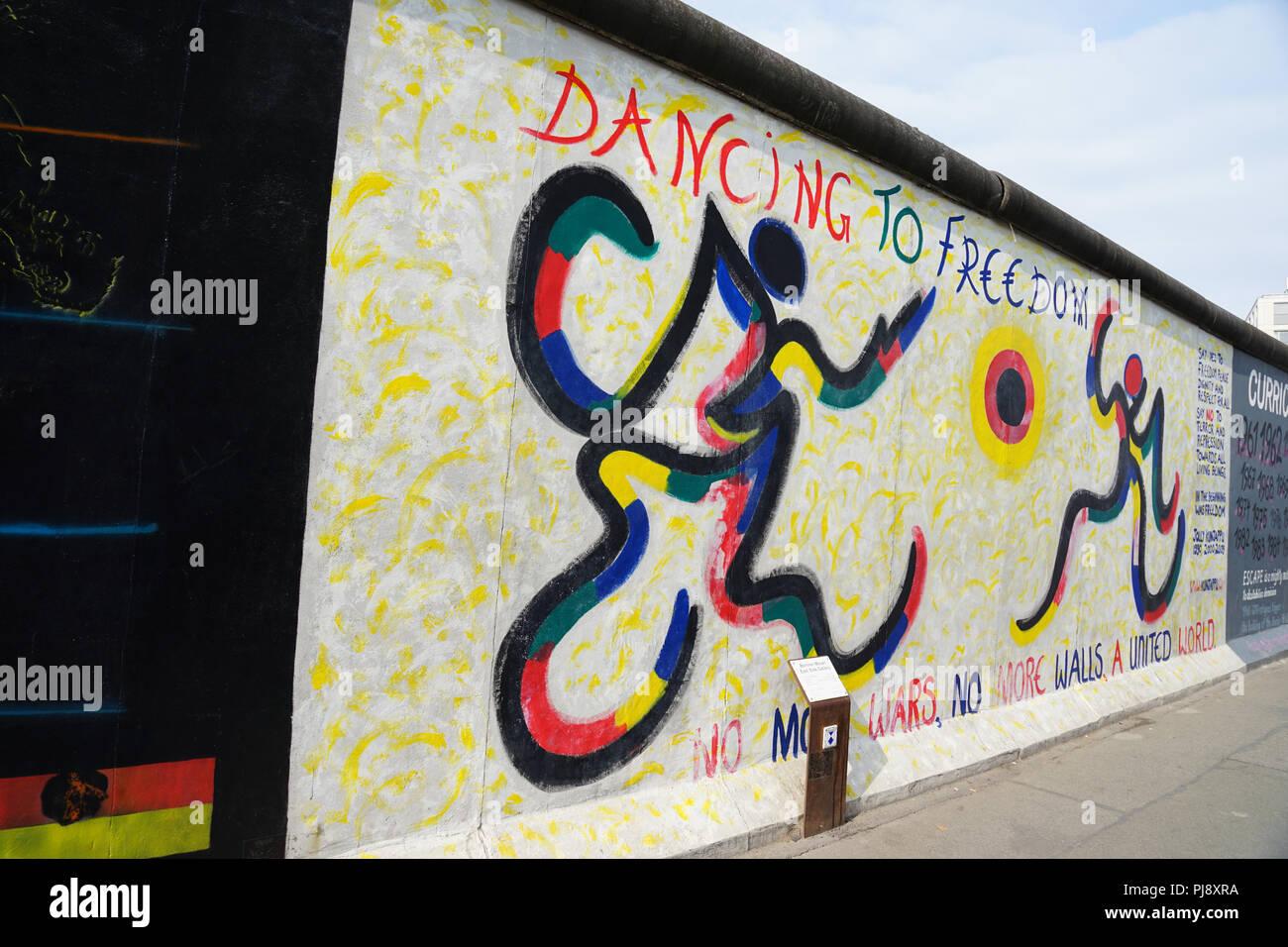 Dancing for Freedom, Art, Eastside Gallery, Berlin, Friedrichshain-Kreuzberg,  heritage-protected landmark, Wall, Berlin, Germany - Stock Image
