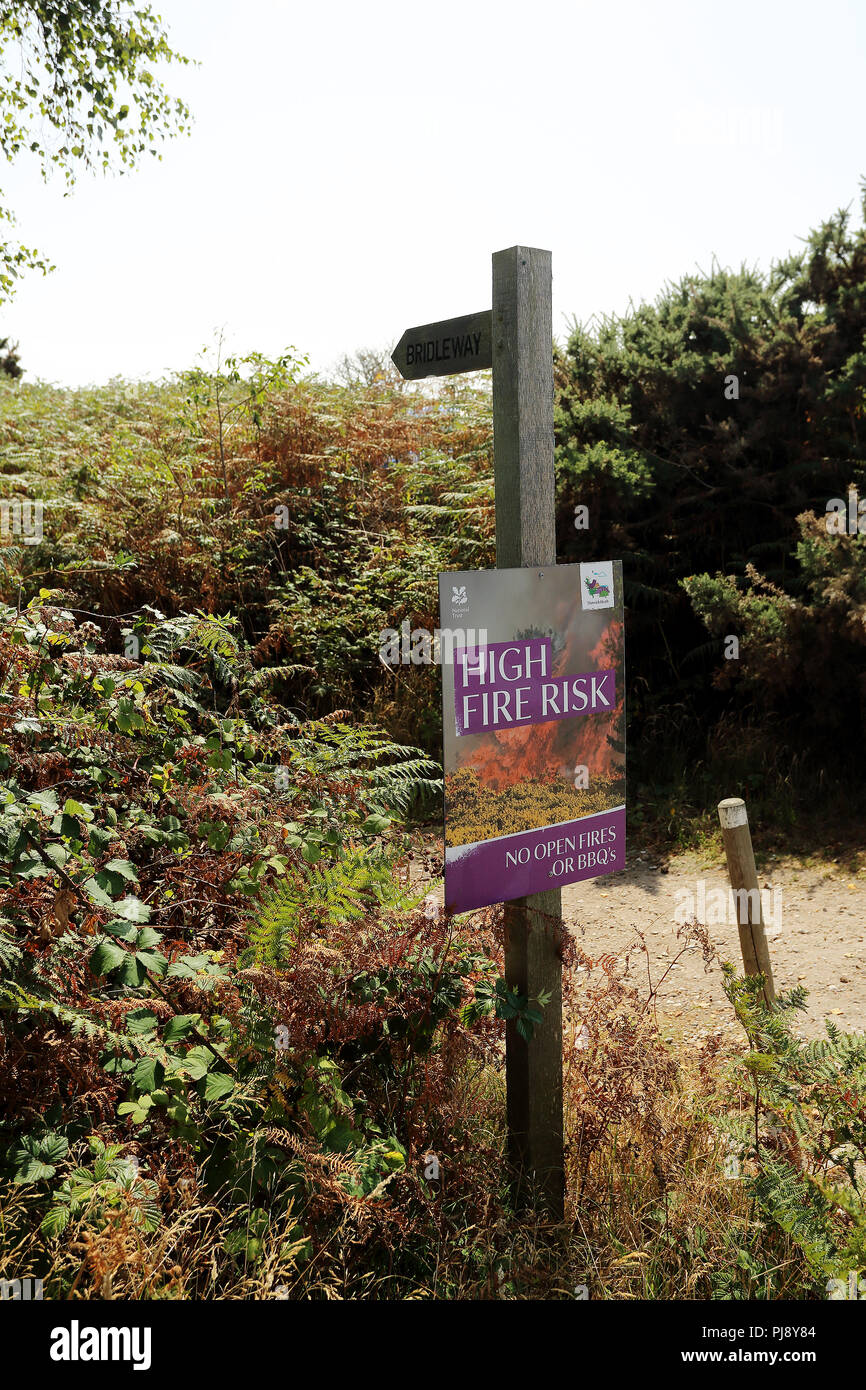 A sign warning of high risk of fire at Dunwich Heath and Beach, Dunwich, Saxmundham IP17 3DJ - Stock Image