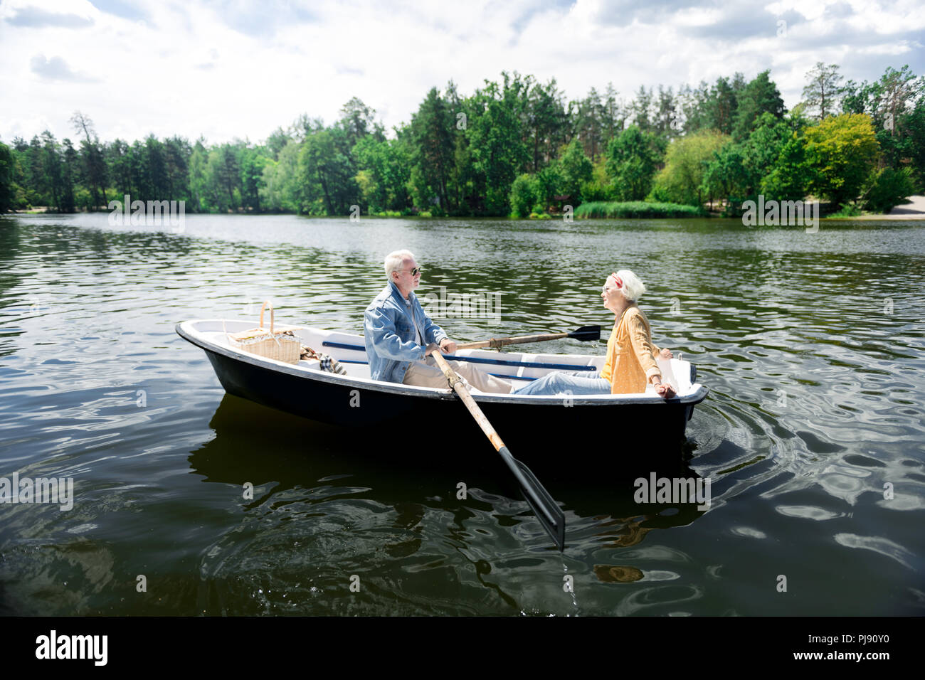 Aged Couple Having Nice Boat Ride While Having Very Romantic Date Stock Photo Alamy