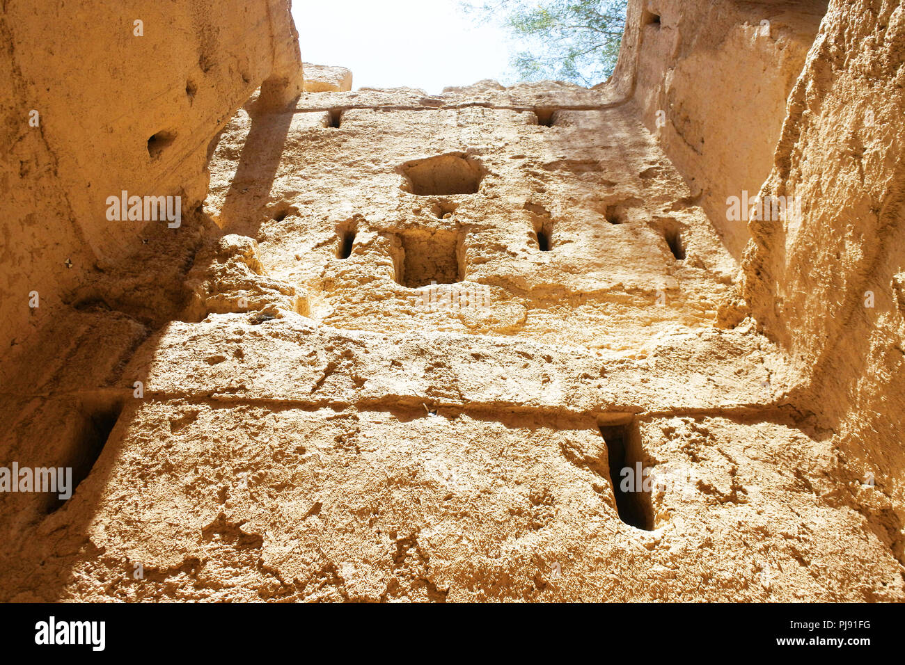 Heritage,Arabic,Old,Vintage, Broken., Old Arabic House, Arabic House. Broken Wall,Old Wall, Mud Wall, Bright,Brown.wall texture - Stock Image