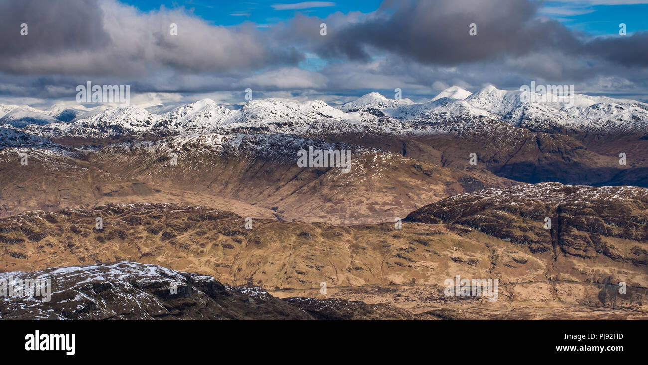 On the summit of Ben Lomond looking north towards Ben More and the remaining spring snows - Stock Image