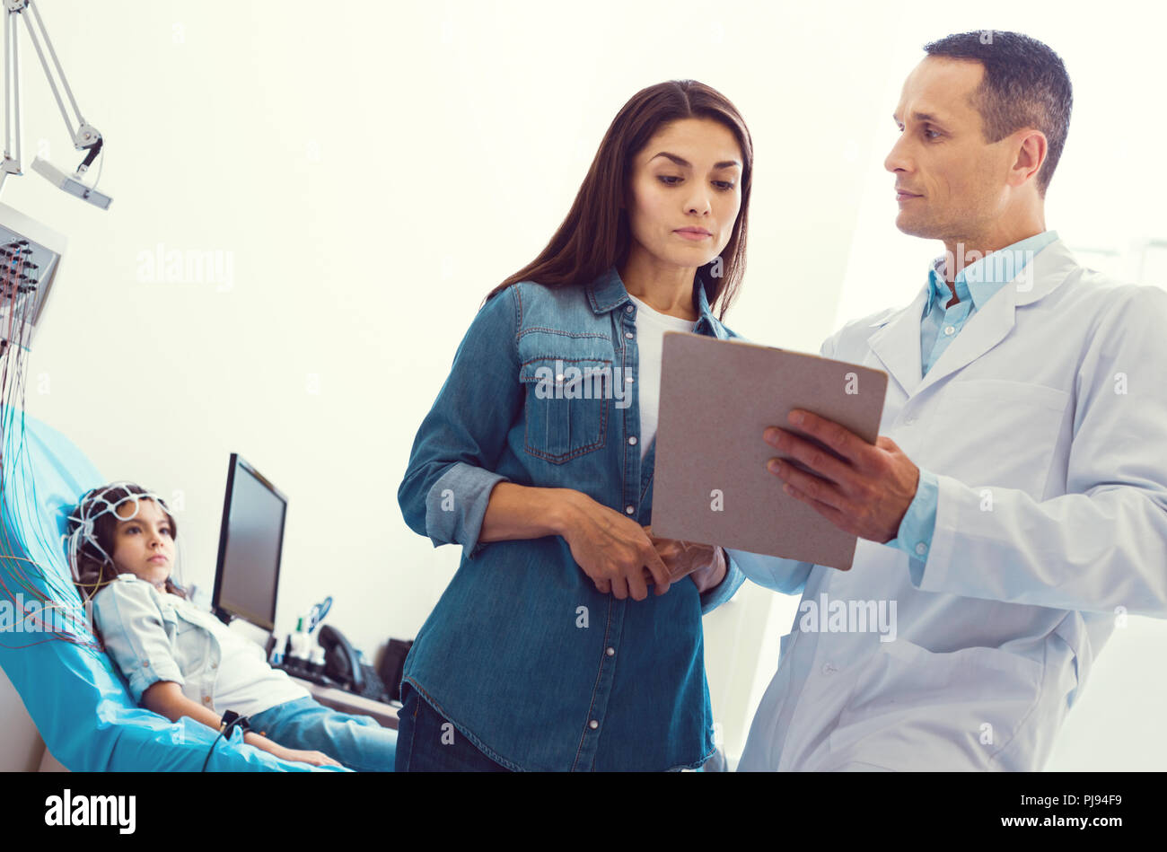 Loving mother and daughter discussing treatment regimen - Stock Image