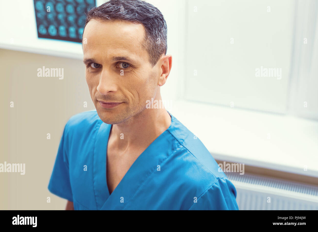 Confident mature laboratory worker looking into camera - Stock Image