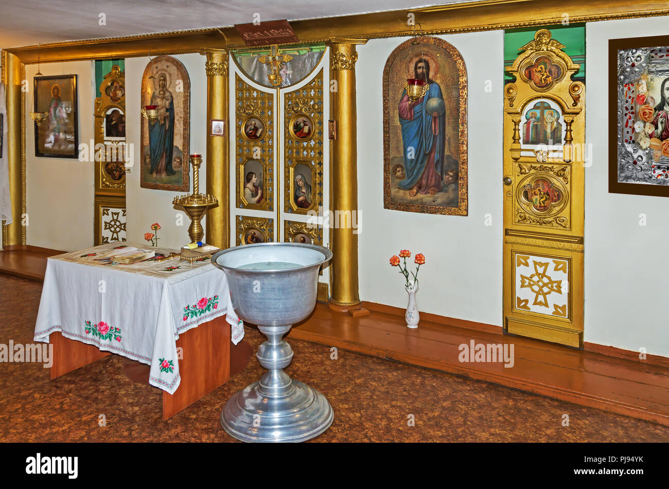 A baptismal font, a throne and altar in the room for the performance rite of baptism in the Orthodox Church - Stock Image
