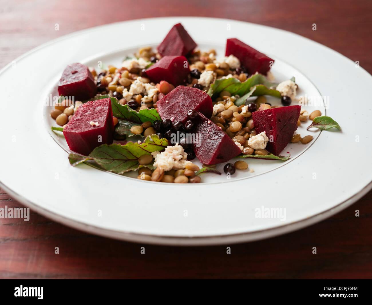 Lentil, beet salad with home made vegan feta Stock Photo