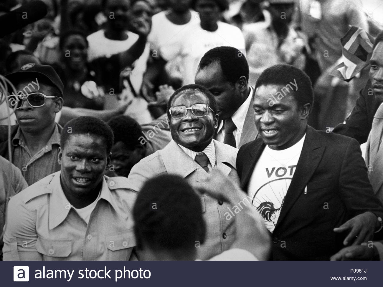 Robert Mugabe arrives back in (Salisbury Rhodesia), Harare Zimbabwe from exile in 1980. Emerson Mnangagwa the new President of Zimbabwe is on the left of Mugabe COPYRIGHT PHOTOGRAPH BY BRIAN HARRIS  © 07808-579804 - Stock Image