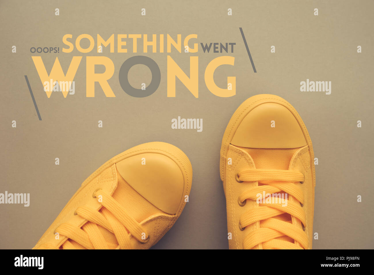 Oops, something went wrong conceptual image with sneakers from above - Stock Image