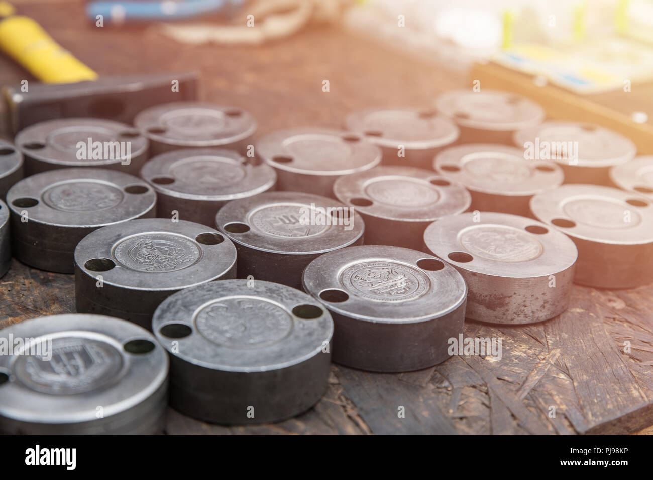 Steel cliche for creating souvenir coins. Tool for creating coins by embossing, hobby - Stock Image