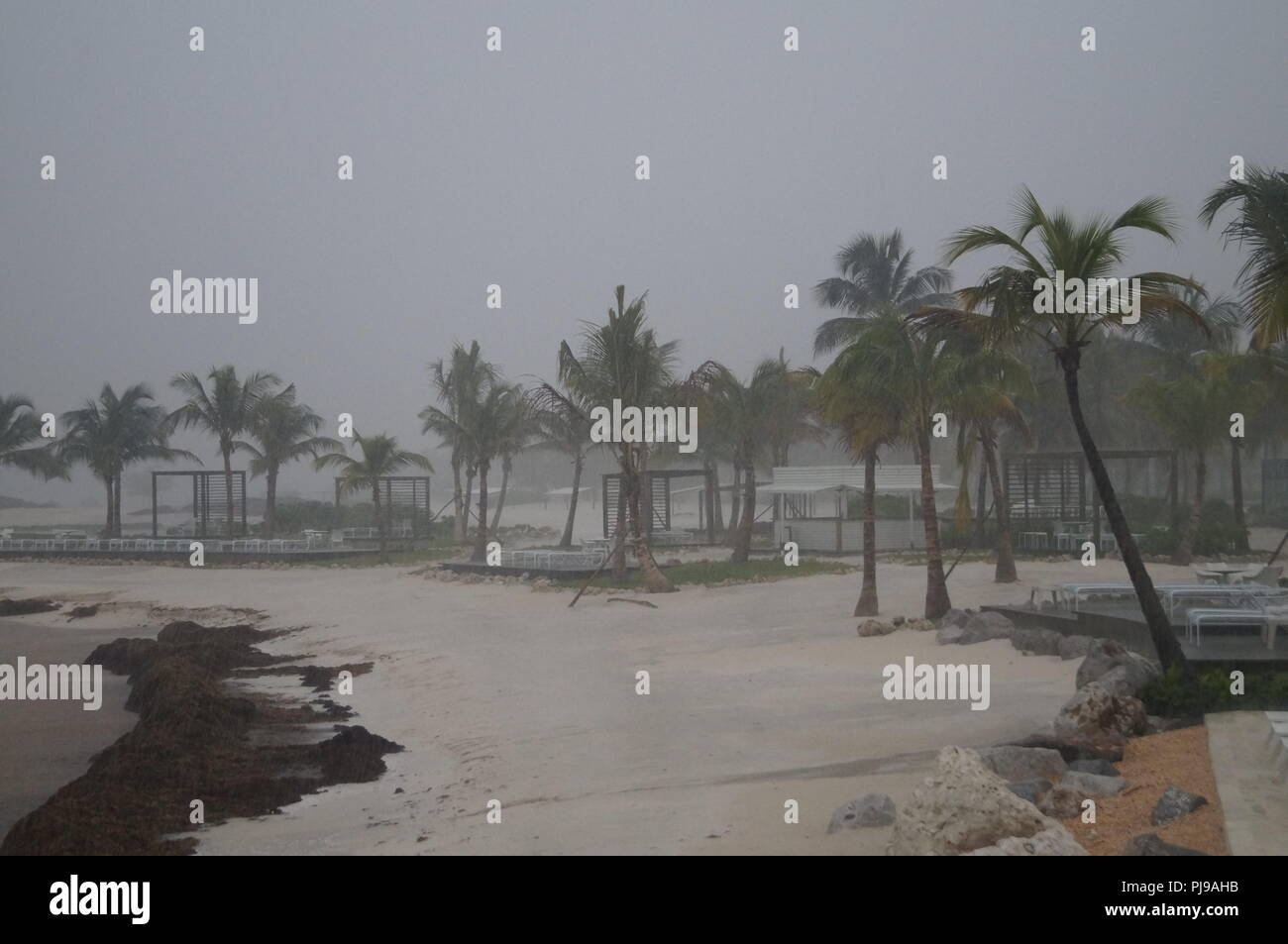Rainy day at a beach on a Caribbean Island during storm season (summer) - Stock Image