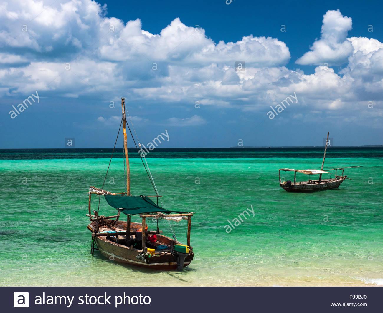 Boats in the turquoise sea, Fumba, Zanzibar, Tanzania - Stock Image