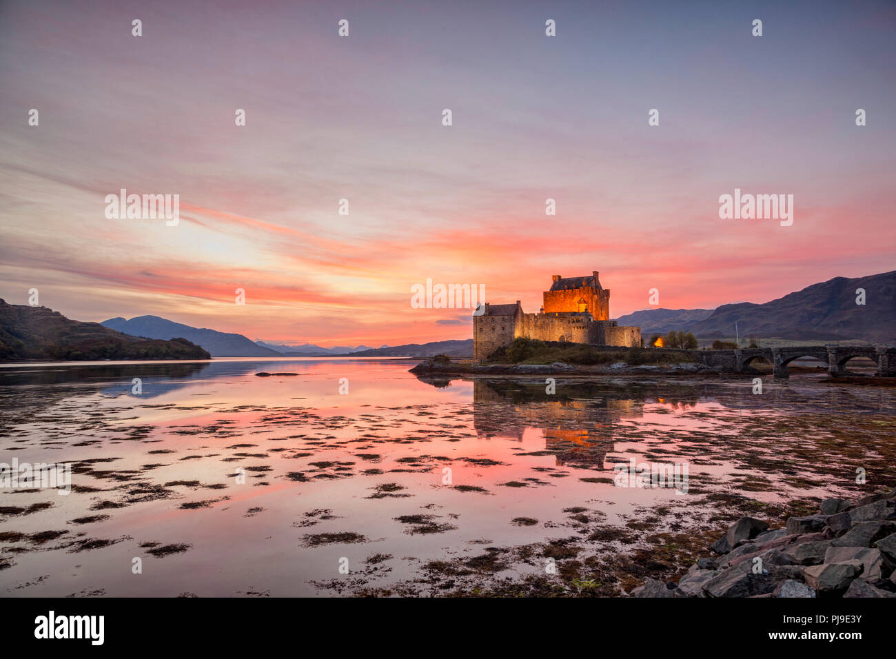 Eilean Donan Castle illuminated at twilight, Highland, Scotland, UK Stock Photo