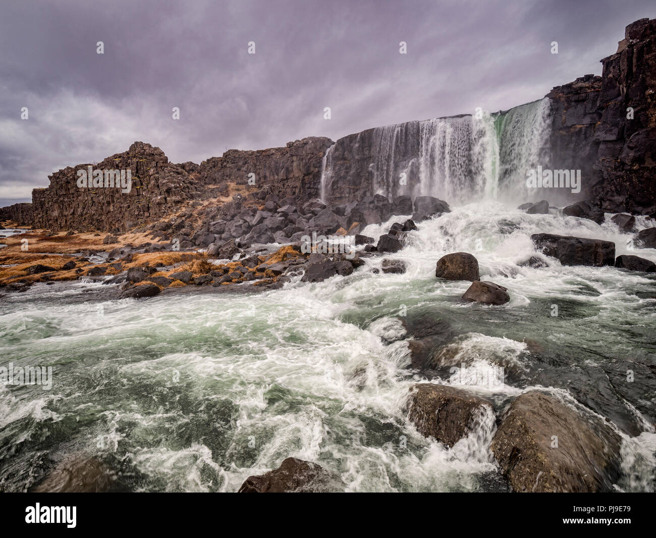 Oxararfoss Waterfall at Thingvellir, Iceland, one of the major attractions on the Golden Circle tourist route. - Stock Image