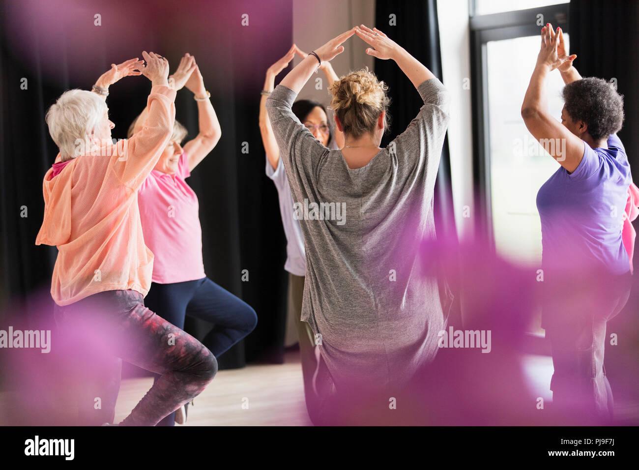 Active seniors exercising in circle - Stock Image