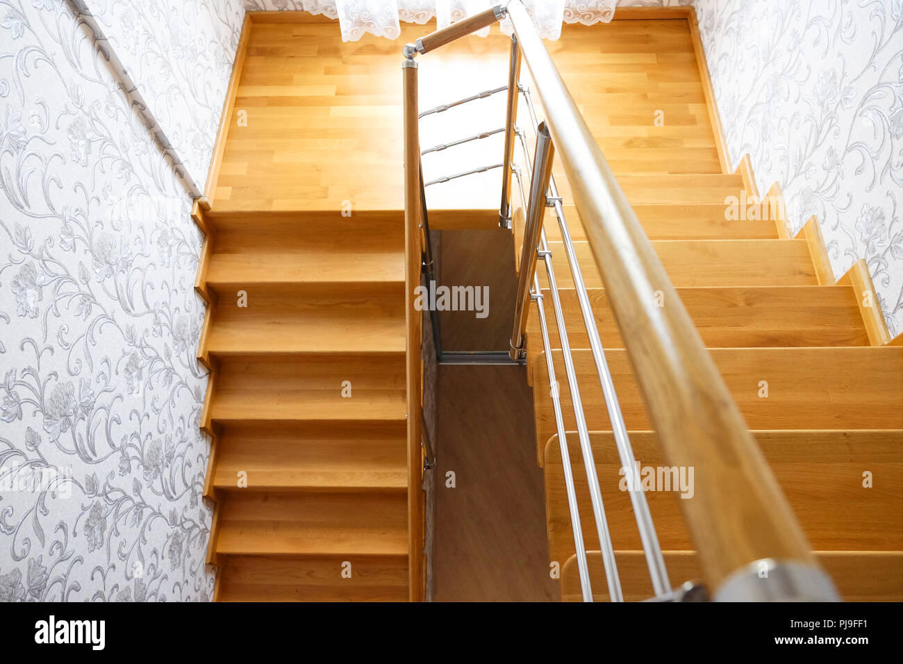 Wooden Staircase In The House. Modern Wooden Staircase Oak Steps. The View  From The Top.