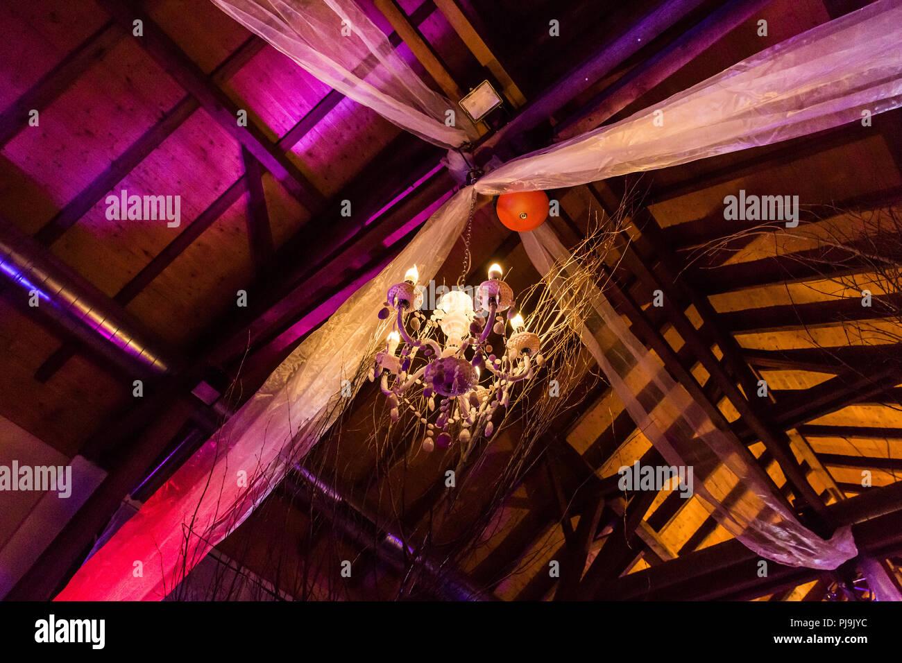 Hanging Chandelier and Tulle Wedding Lighting Stock Photo