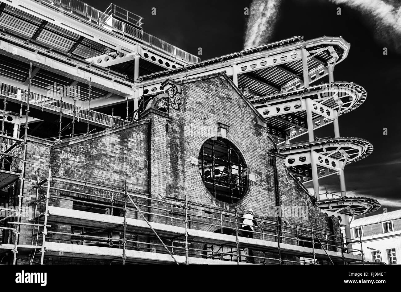 Dublin, Ireland, March 2018, a construction site where modern architecture is add on a old building facade - Stock Image