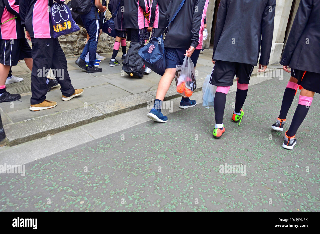 Schoolboys going to a sports lesson in uniform sports kit - London, England, UK. Stock Photo