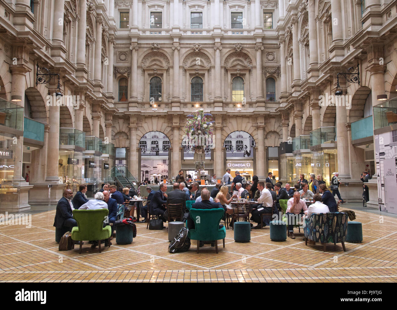 People in the cafe of the Royal Exchange, London - Stock Image