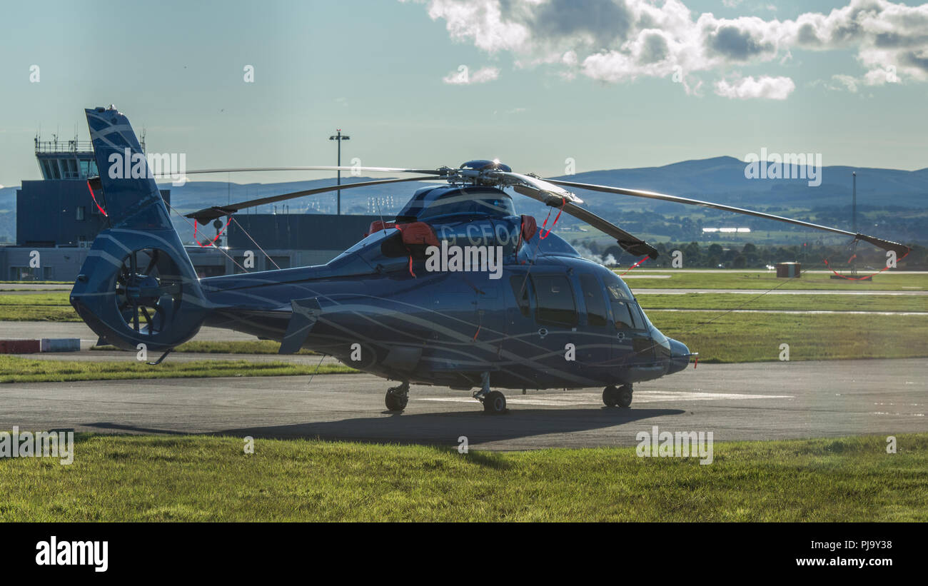 Airbus' twin-engine H155 (formerly the EC155 B1) seen at Glasgow Airport, Renfrewshire, Scotland. - Stock Image