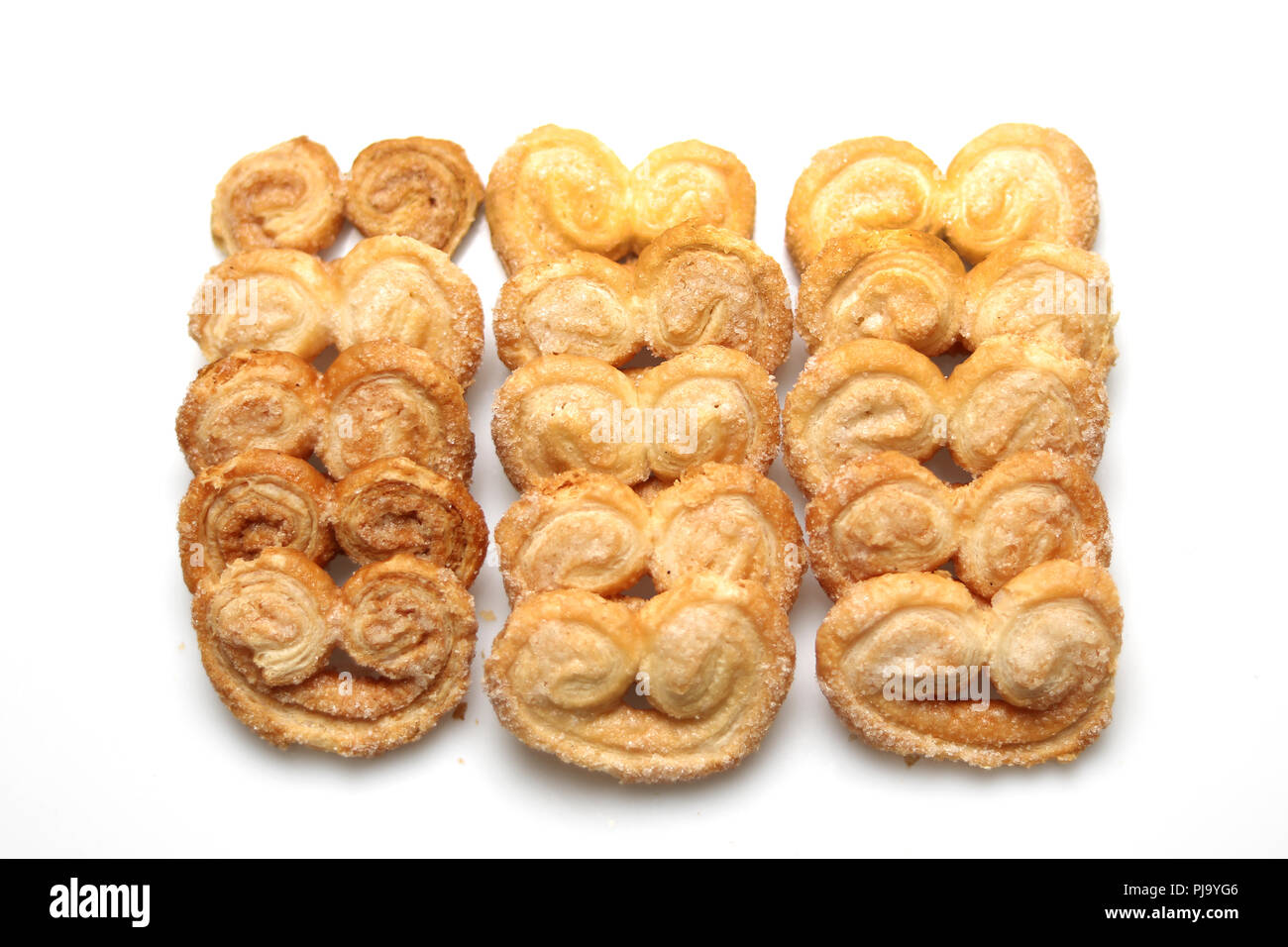 Typical sweet cookies from Argentina called palmeritas. Shot taken on a white background - Stock Image