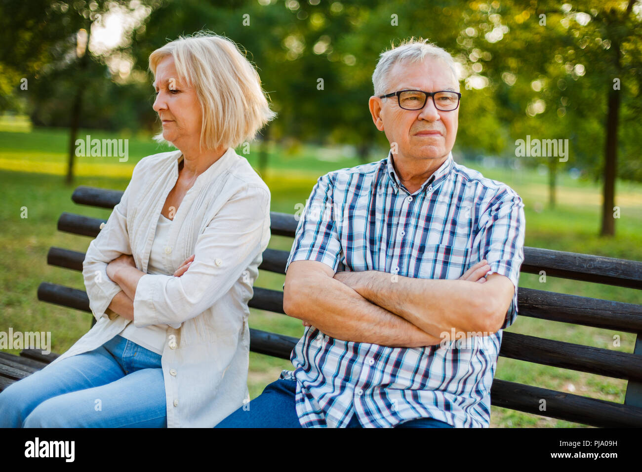Senior couple is in dispute and not talking to each other. Stock Photo
