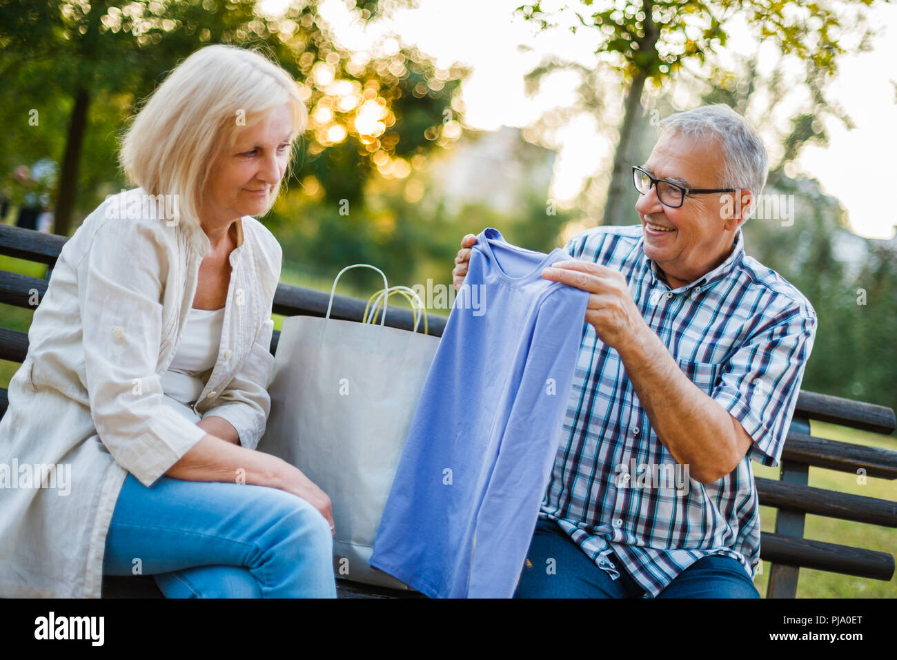 Woman is displeased with gifts from her man. - Stock Image
