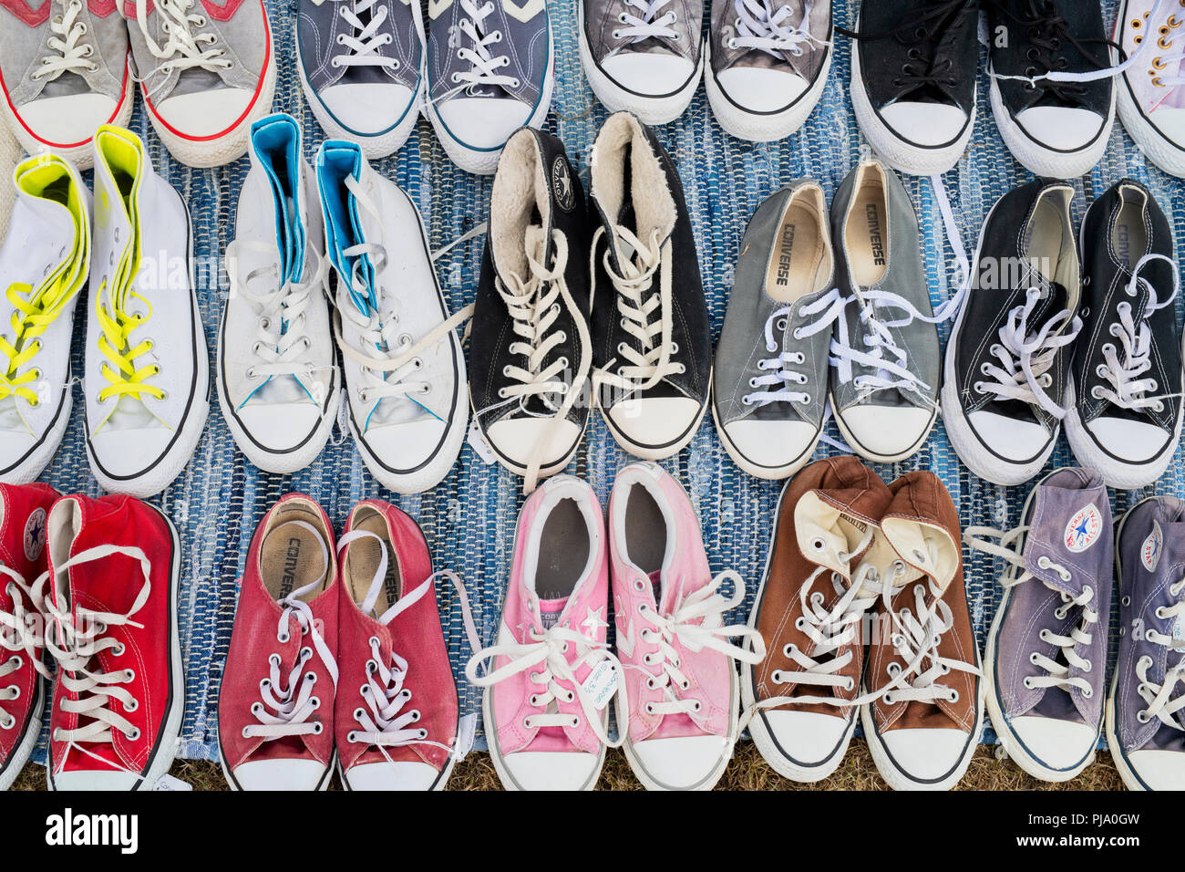 Converse trainers pattern. Converse trainers for sale on a stall at a vintage retro festival. UK - Stock Image