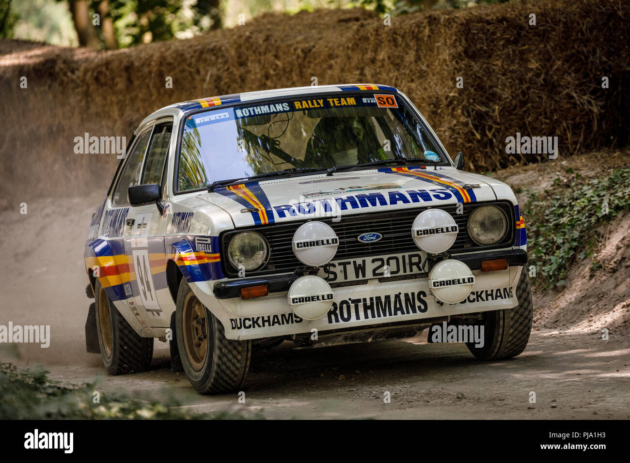 1977 ford escort mk2 rs1800 with driver alan watkins on the forest rally stage at the