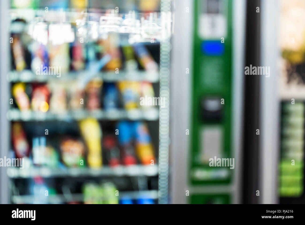 Blurred image of vending machine with snacks - Stock Image