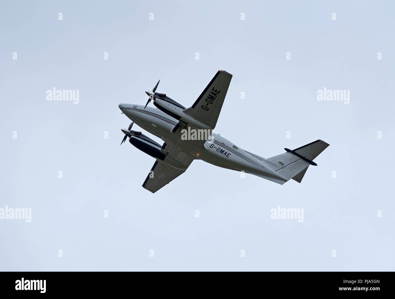 Departing from Inverness Airport is this Beechcraft B200 Super King air G-GMAE. Stock Photo