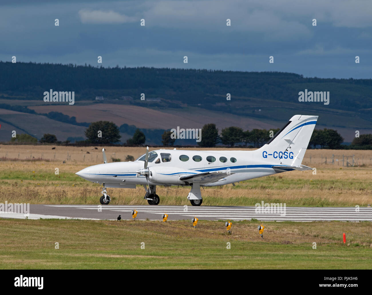 Cessna 421 C Golden Eagle arriving at Inverness Airport from the south of England. - Stock Image