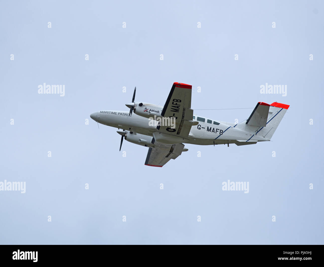 A marine & Fisheries Board twin engined aircraft leaving Inverness for a surveillance flight round the Orkney Isles to protect rising interests. Stock Photo