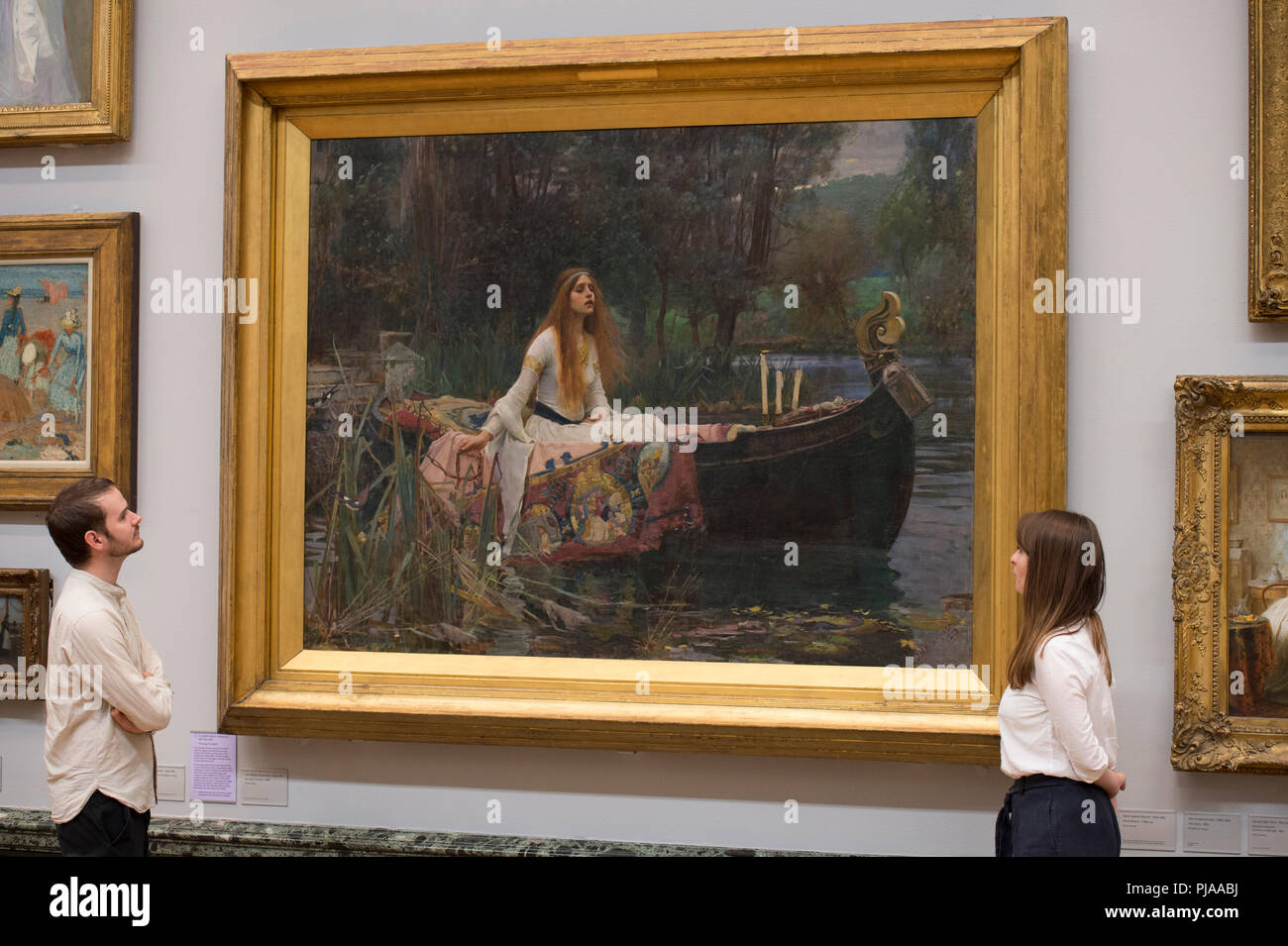 Tate Britain, London, UK. 5 September, 2018. Tate Britain staff with John William Waterhouse's The Lady of Shalott 1888 to mark the launch of a major new exhibition at the National Gallery of Australia. Over forty works from Tate Britain's collection of Pre-Raphaelite art will be loaned to the National Gallery of Australia in December for a major new exhibition. Credit: Malcolm Park/Alamy Live News. - Stock Image