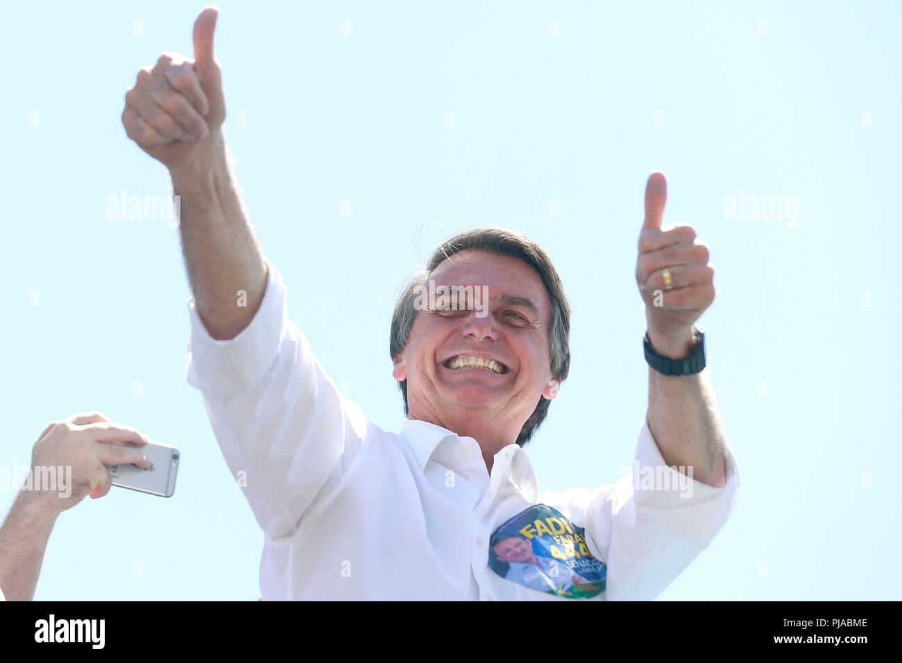 Brasilia, Brazil. 05th Sep, 2018. Candidate to the Brazilian presidency of the PSL party, Jair Bolosnaro, participates in a campaign act, in Brasilia, Brazil, 05 September 2018. The presidential election will take place in October. Credit: Joedson Alves/EFE/Alamy Live News - Stock Image